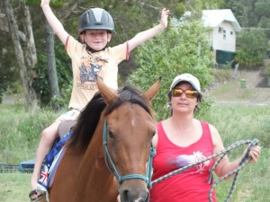 Ryan Sharman happy on a horse at the Rainbow Beach Markets