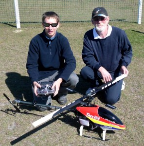 Nathaniel Inskip (left) prepares his Align TRex 600 helicopter for the fly-in watched by event director Greg Grover