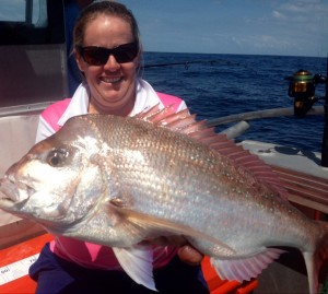 Michelle with her birthday present, a nice Snapper - photo from Double Island Point Fishing Charters