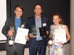 "Heatley Gilmore with eldest two Jack and Kate with the ""haul of takeaways""  from the Queensland Country Press Association Awards Image courtesy Les and Adele Jasper"