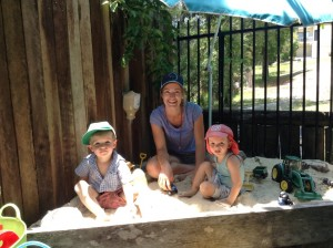 Family day care educator, Kim, having fun with James and Henry