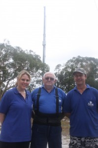 Saturn Antenna's Laurinda Spencer, Rod Farr and Tony Grant at the tower, only metres from their workplace but since the retune, say their TV reception is patchy or nil