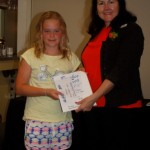 Acting Mayor Rae Gate presents 9 year old Annie White the Young Artist Award where she competed against 16 year olds!