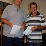 Robin Hines accepts the Oil Section prize from Rainbow Beach Tourism Centre's Sam Mitchell