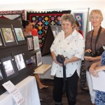 Camera Club members, Jan Blackshaw, Mary Boyce and Julie Hartwig, winner of the Landscape Photography Section, admire the photos