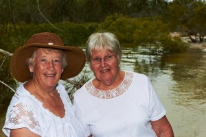 Carmel and Margaret in front of the swimming spot at the picnic area at Bayside Park, Cooloola