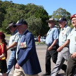 Local RSL President, Joe Casey and his granddaughter led the March