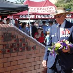 Ray Parker lays a wreath for the Good Shepherd Church