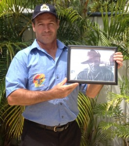 William Brown RSL Secretary Darren Davies holding a frame with his Great-Grandfather William Brown