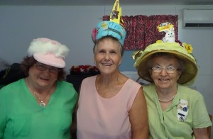 Linda Murphy, Lorraine Bishop and Elwyn Slaughter at an impromptu Easter Bonnet Parade produced quite a variety of headwear - which generated much laughter and cheer!