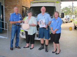TCB Lions Philip Davey (President) and Rachel Fender (right) present a cheque to CCLAC President, Lillian Clark with one of the manikins, QAS Cooloola Coast OIC Wilbur Fahey Image supplied