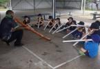 Maurice Kissier shows Rainbow Prep boys the didgeridoo