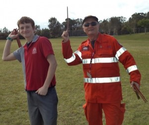 Lochlan Embury with SES volunteer learning to throw a boomerang