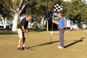 Mark Southern and President Phillip Davey are sneaking in some practise for the Lions Annual Charity Golf Day