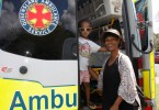 Amir Matthews hops on board the ambulance with mum, Lily