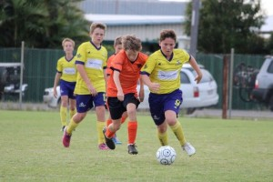 Levi McDermott (with the ball) adores soccer - and now he'll be playing for Australia! Image supplied