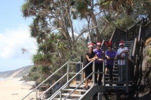 Talia from Arcobaleno and Renae, John and Simon from Rainbow Beach Hotel say Christmas has come a little early - council have just opened our brand beach steps
