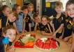 Alex and Zoe Kingsley (seated, centre) were so proud to know that Dad had sent in fruit and veg from Rainbow Fruit to make a delicious platter for their fellow Year 1/2 students