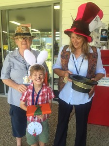 Librarians Caroline Taylor and Jenny Tanner with Kye Feeney who won the best dressed