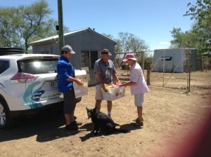 Handing over supplies to Jennifer McKay 60kms west of Longreach. They have been on a 60,000 acre family-owned property for 103 years. This is the first time this family has apparently asked for help. It was hard, they battle on and on - and still about 8000 sheep. As you can see they missed the rain.