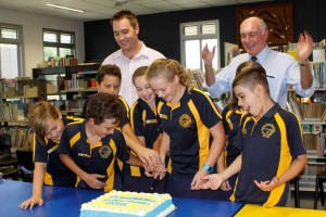 Micheal Grogran and Honorable Warren Truss, Federal Member for Wide Bay, congratulate the new student leaders as they cut the cake at the special celebratory morning tea with their families