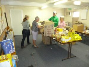 Unpacking drought relief items at St Brigid's Hall, Longreach