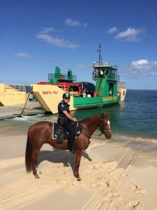 Senior Constable Proctor and Troop Horse CJ at Inskip Point with the Fraser Island Ferry.