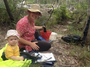 Bonnie assists mum, Jess Milne, take a water sample reading at Snapper Creek for Cooloola Coastcare