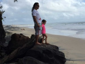 Edwin Hapi and Zia McPherson  play on the rocks at Rainbow Beach - just the day before this rock was hardly exposed!