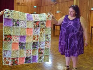 Sue Maddison with her cuddly quilt