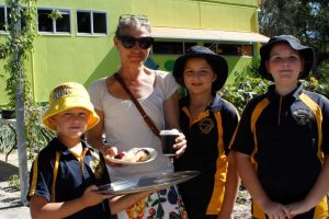 Guy Bergin serves up a cuppa and delicious scones made by Mrs Young's Grade 2/3 class to Denise Crowley, whilst Elva and Mikayla prepare for her tour