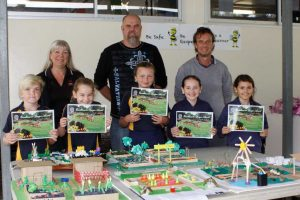 Chappy Ronnie, Judge Michael Donnelly and Mr Mileson with the winners of the 3/4 garden design: Seth, Ruby, Luxie-Leigh, Rose and Tia. The Funlantis gardens will be on display when Costa visits July 11