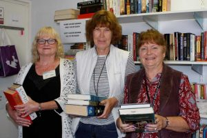 Volunteers Lillian Cook, Jennifer Williams and Eileen Holyoak invite you to the Resource Centre Book Sale!