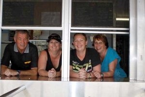 Phil Davey, Bec Reibel, Megan Grove and Annette Davey are asking for help in the tuckshop!