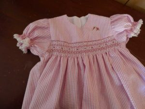 Jan Low made this pretty child's dress with smocking needlework