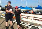 Coastguard representative John MacFarlane receives a donation from President Sandra Wooster