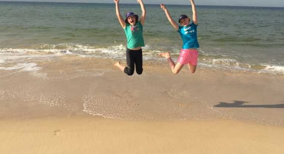 12-year-old twins, Olivia (left) and Jacinta Sullivan are jumping for joy to be at the best winter beach away from cold Toowoomba! Image Alison Sullivan