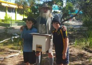Brydon and Chase helping Cecil install the new bee hives