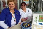 Irene Manwaring and Debbie Vines selling QCWA raffle tickets