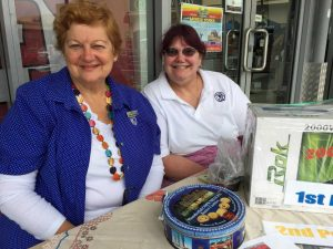 Irene Manwaring and Debbie Vines selling QCWA raffle tickets