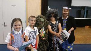 Book Week Fancy Dress winners: Xanthe-Leigh Sheridan, Noah Duncan, a well camouflaged student, Logan Smith and Library Teacher Aide, Mrs Sue Dan