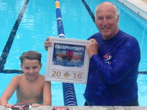 Wyatt Lee has had an awesome winter of swimming with an  outstanding effort at Queensland State Championships last month, pictured with Crocs coach, Greg Rogers