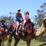 It was all smiles on the camel ride for locals Wynetta and Skye Duggan