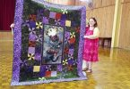 Sue Maddison with her beautiful quilt