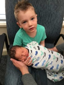 Big brother Hudson was delighted with baby Tanner