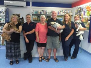 Jenny Eising with Buddy, vet Dr Cathy Milgate, Carol and Terry James with Scruff, team members Sandy Morton and Debbie Davey with Roxy