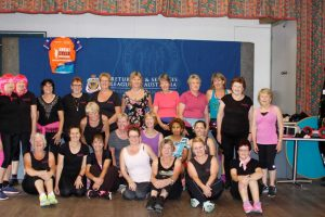 Emillia - surrounded with her devotees who make the Thursday pilgrimage to Zumba - and the Gympie Zumba ladies are keen to return Image Donna Hope
