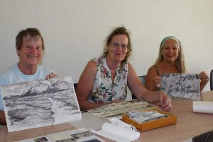 Gayle Young, Ann Thornton and  Ze show off their creations from the library art workshops