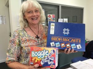Coralie Leslie from Community Information and Resource Centre shows some of the games for hire