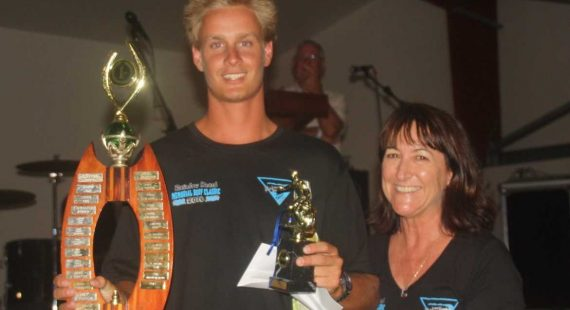 Ryan Cozens is presented with the original Robert Pryde Open Perpetual trophy by Robert's sister, Lyn Hourn